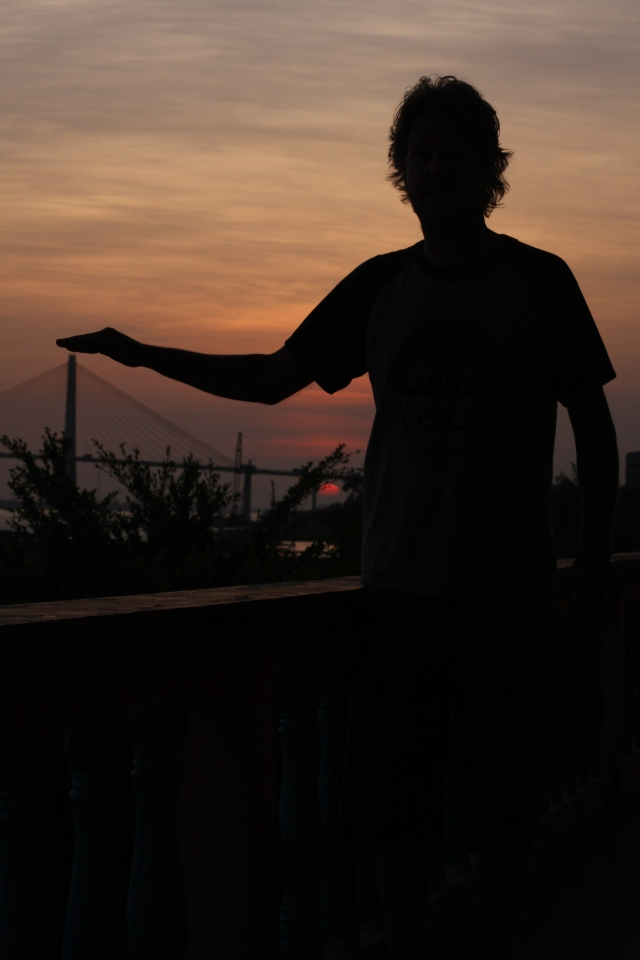 Joel Each has his thumb on the Mekong Delta in the midst a glorious Asian sunset