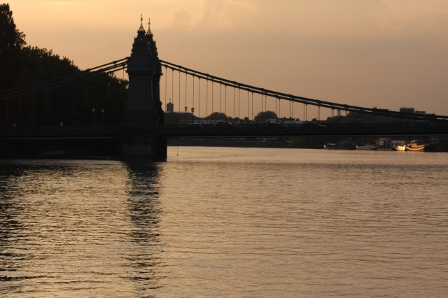 London's Hammersmith Bridge stands eminently as the sun says goodbye to another day. ©